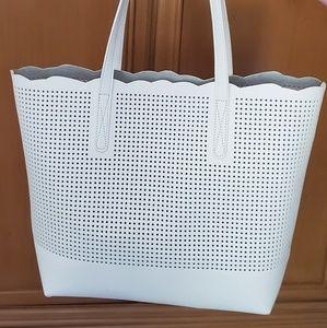 Neiman Marcus white leather tote.